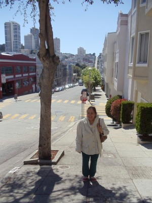 Mum feeling pleased have scaled a pretty steep street