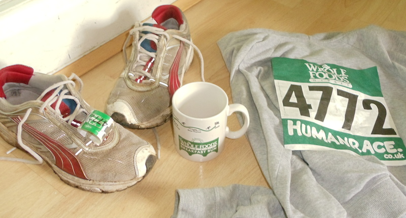A running mug, dirty trainer s (gross) and my number.